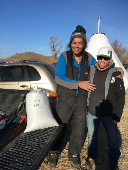 Dan dropping wild rice off to Lee Sprague, of the Cold Water Rescue Team, at Pueblo camp. Photo by Elizabeth Hoover