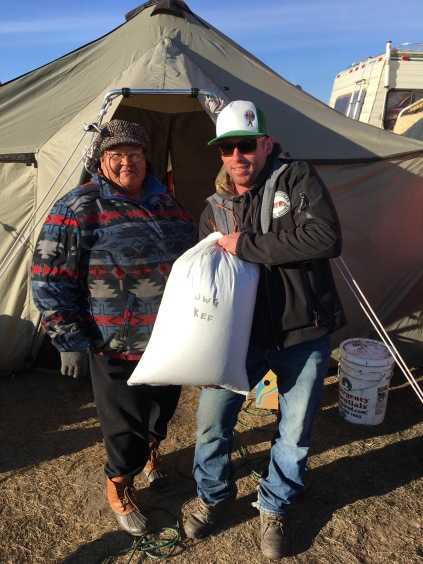 Dan dropping off wild rice to Winona's Kitchen. Photo by Elizabeth Hoover