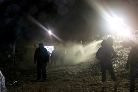 icy water sprayed on water protectors. photo by Elizabeth Hoover