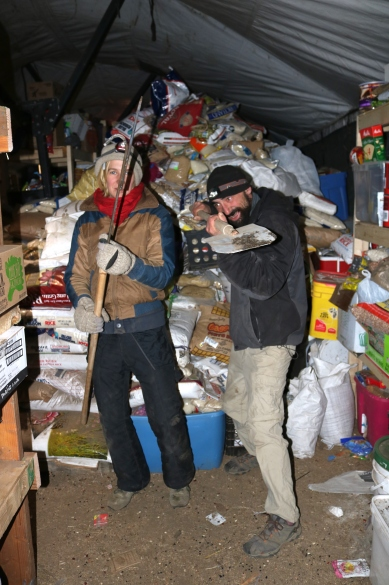 Volunteer in headlamps, tasked with sorting through mountains of donations. Photo by Elizabeth Hoover